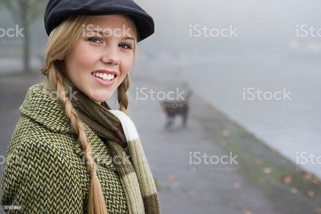 Young woman alone in park stock photo