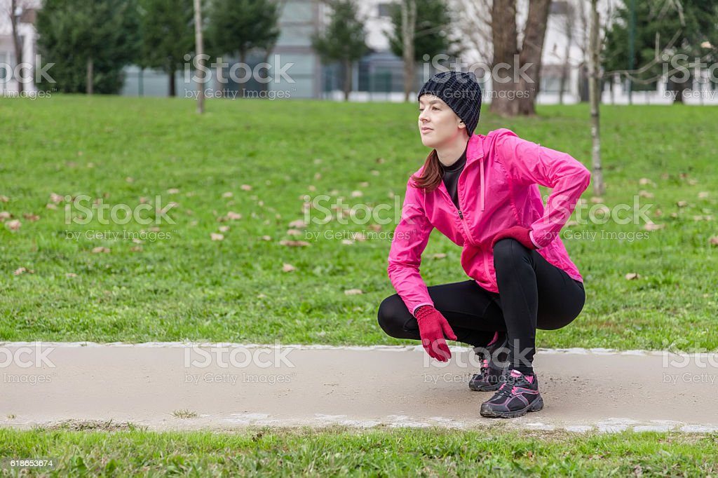Young woman analyzing the track before running stock photo