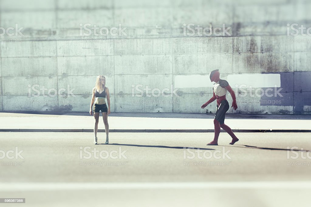 Young woman and alien, city stock photo