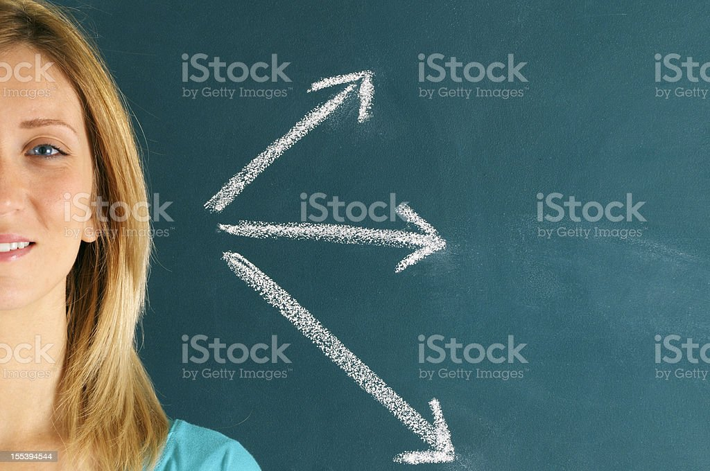 Young Woman and Arrow Sign. Copy Space. royalty-free stock photo