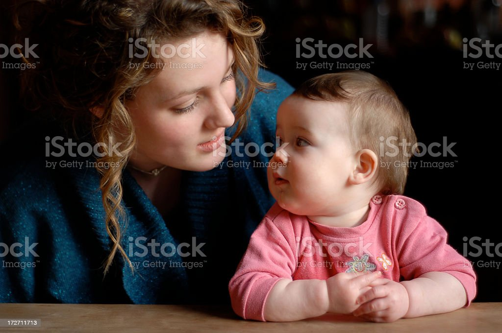 Young Woman and baby stock photo