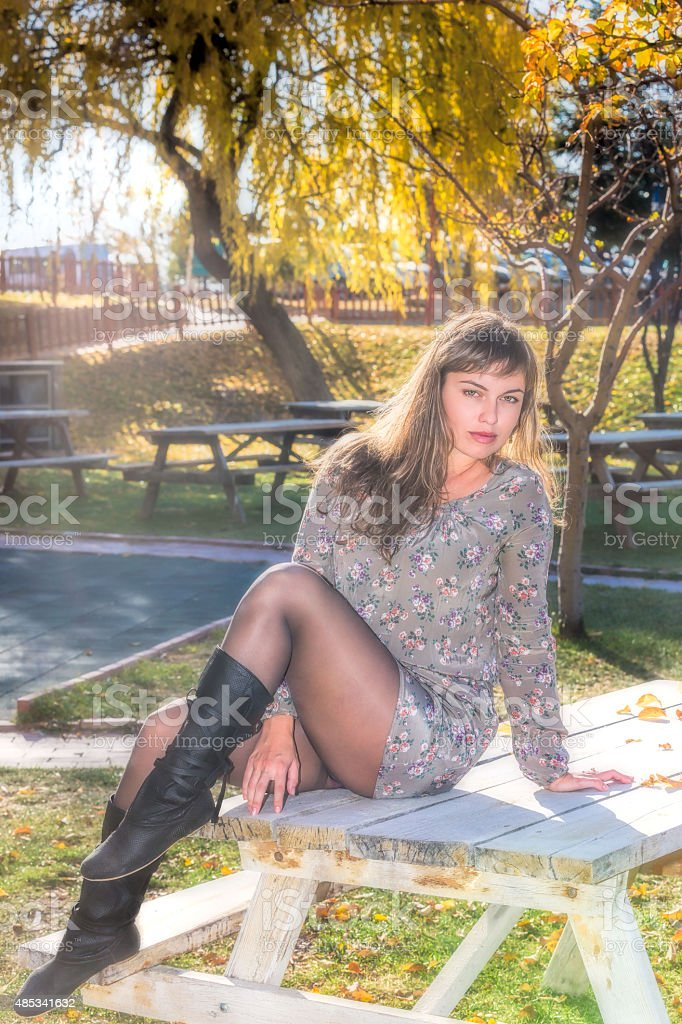 Young Woman and Beautiful Autumn stock photo