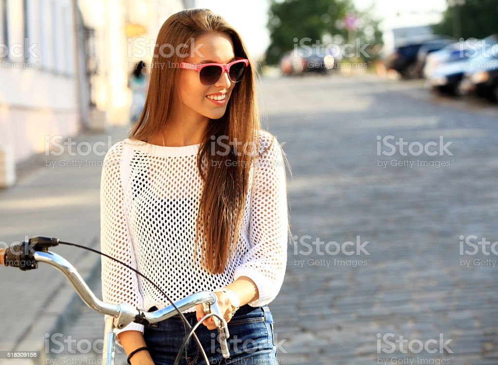 young woman and bike in city stock photo