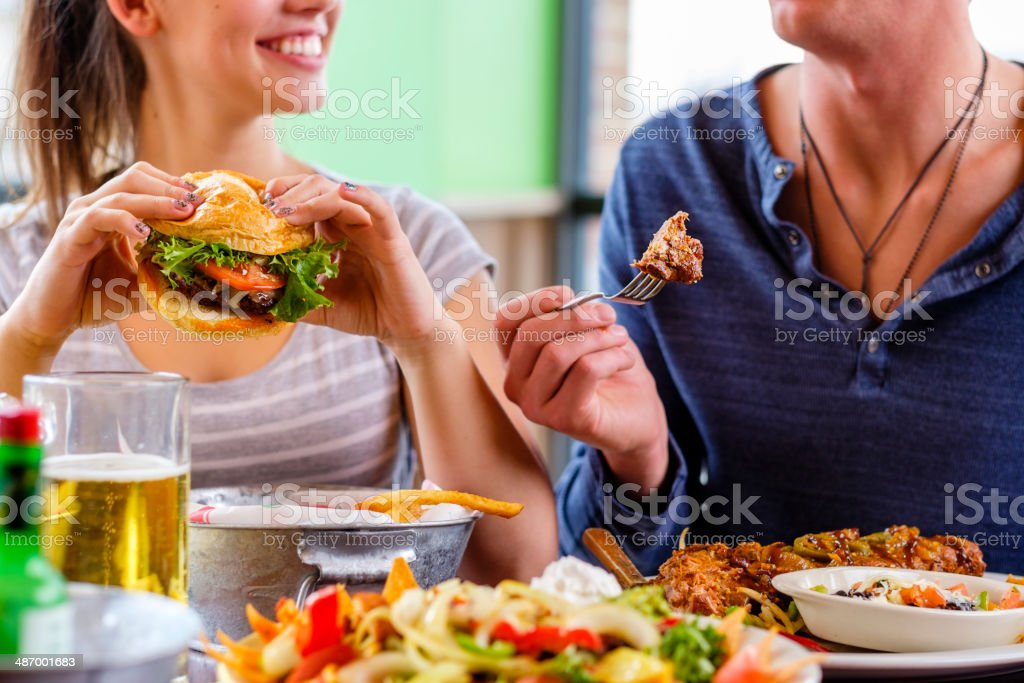 Young Woman and Burger stock photo