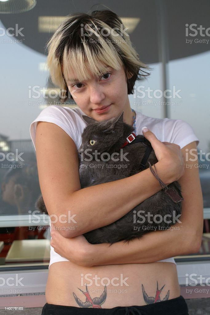 young woman and cat royalty-free stock photo