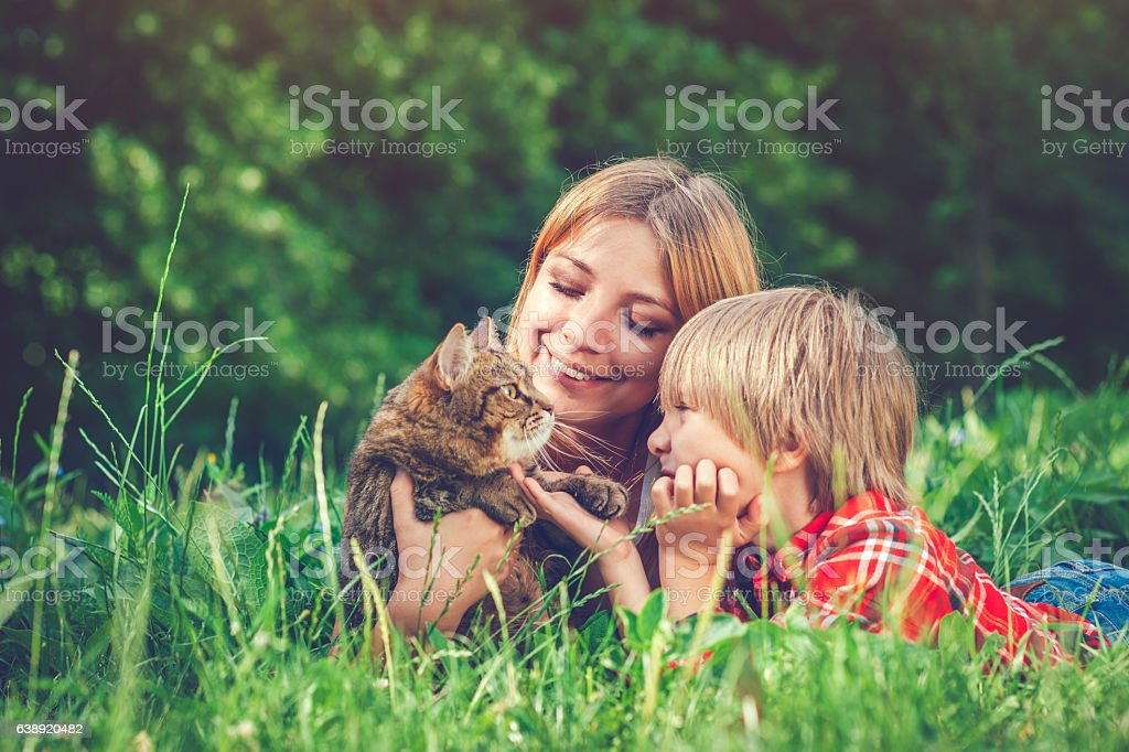 Young woman and child and her cat stock photo