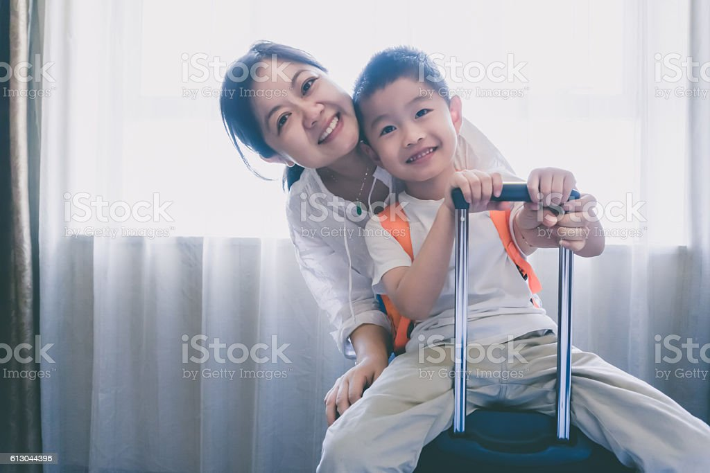 Young woman and child in hotel room stock photo