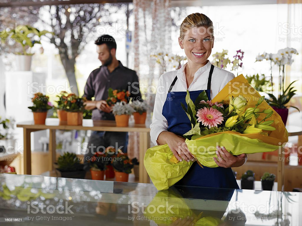 Young woman and client in flowers shop stock photo