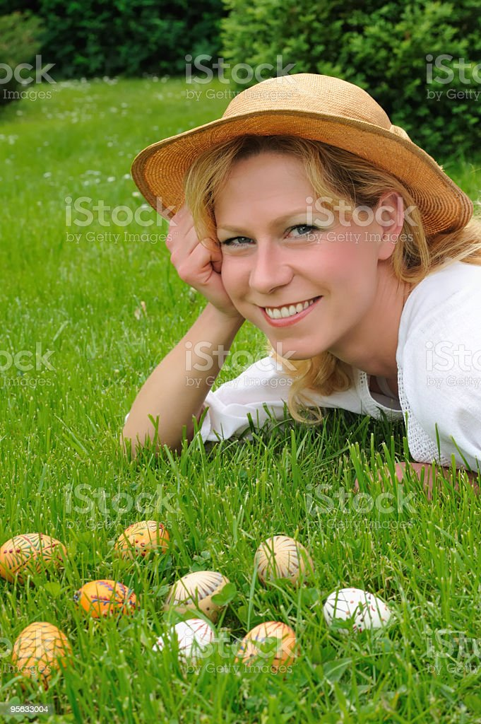 Young woman and Easter eggs on the grass royalty-free stock photo