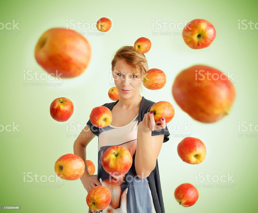 Young woman and flying apples stock photo