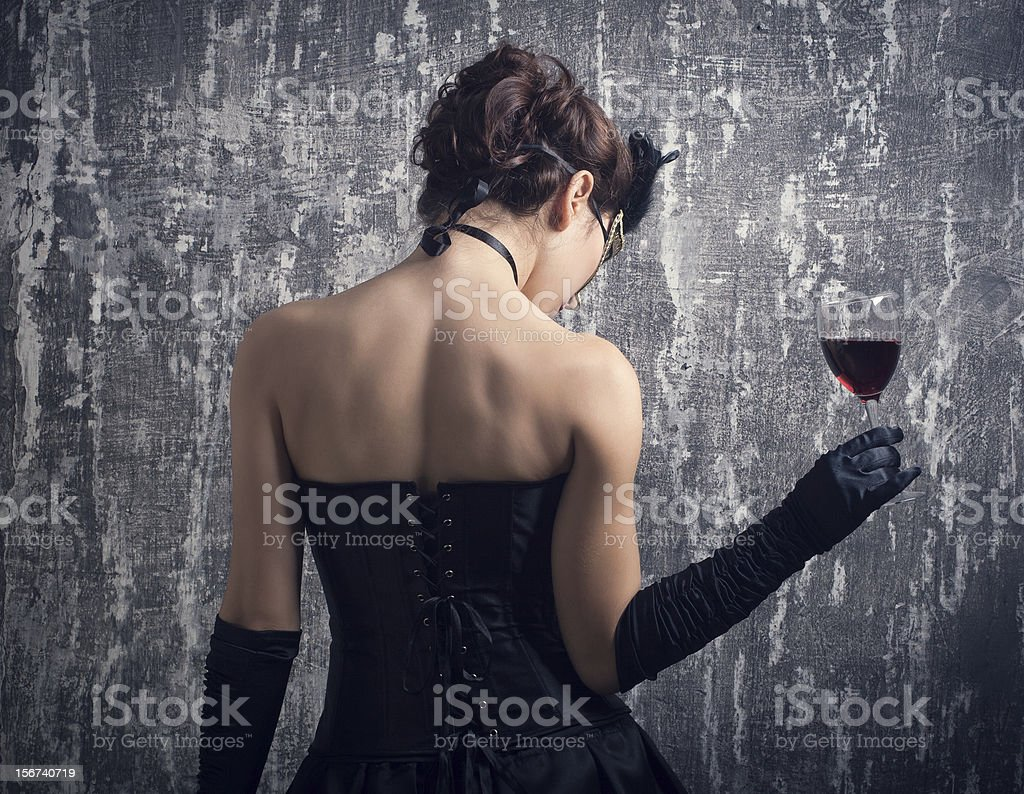 young woman and glass of red wine. royalty-free stock photo