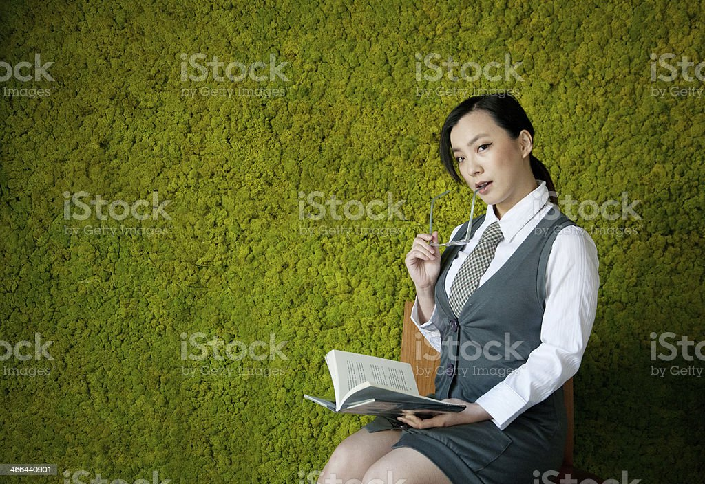 Young Woman and Green Wall stock photo