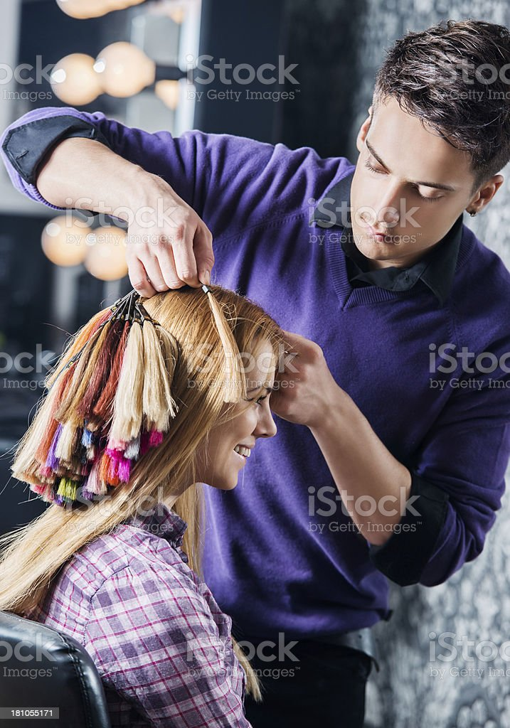 Young woman and hairdresser. royalty-free stock photo