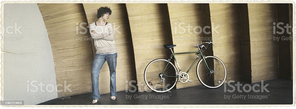 Young Woman and Her Bicycle stock photo