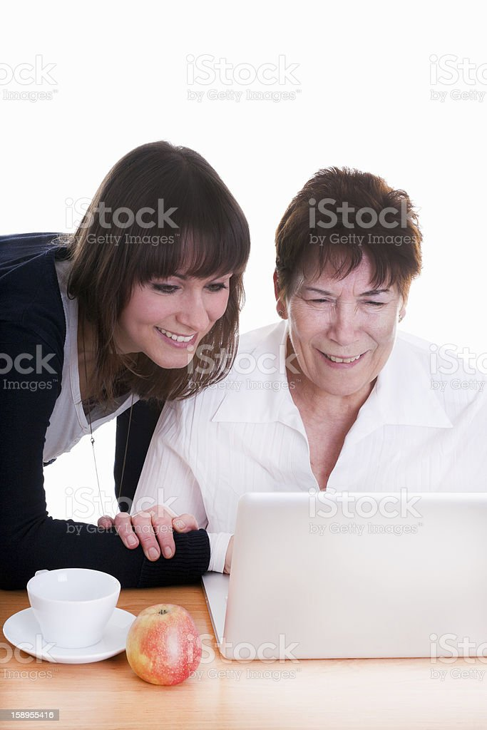 young woman and her grandmother working on laptop royalty-free stock photo