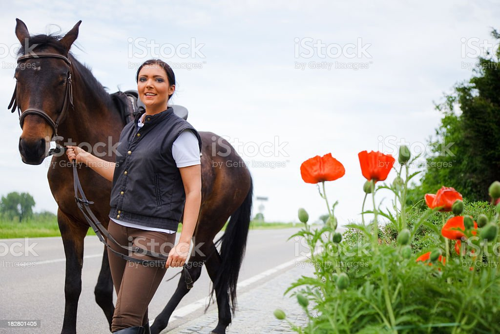 young woman and her horse royalty-free stock photo