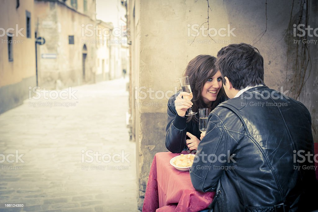 Young woman and man at the cafè royalty-free stock photo