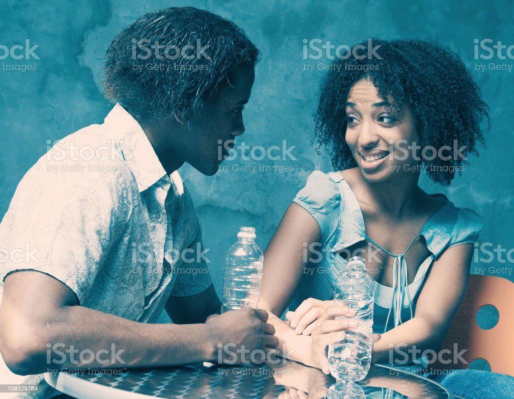 Young Woman and Man Flirting stock photo