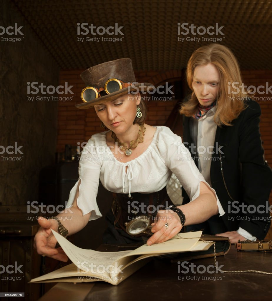 Young woman and man in vintage steampunk-style dressing stock photo