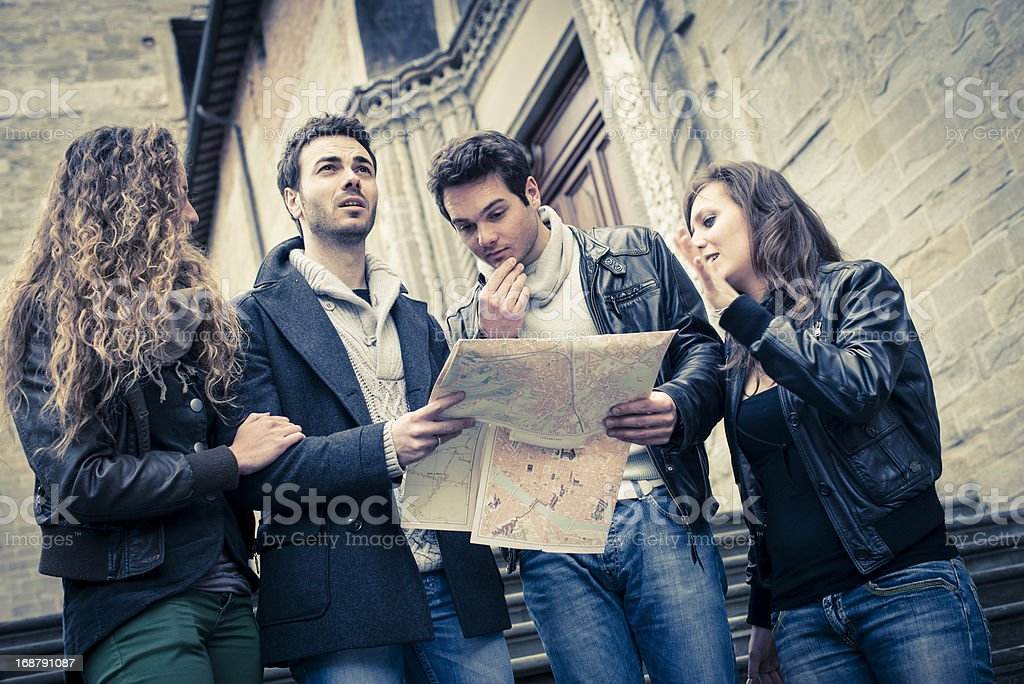 Young woman and man with city map royalty-free stock photo
