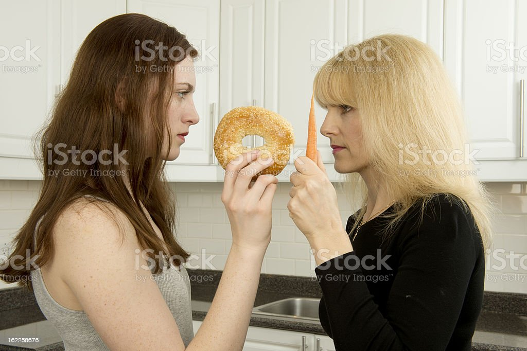 Young woman and mother argue over food royalty-free stock photo