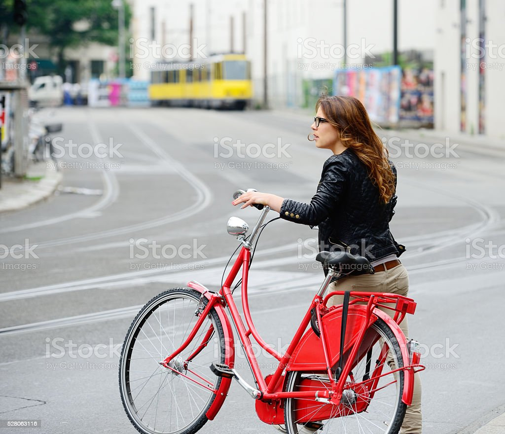 Young woman and red bike stock photo