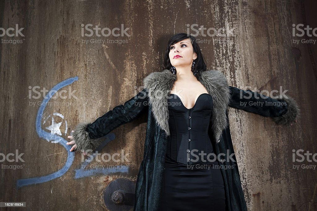 Young woman and rusty pipe royalty-free stock photo