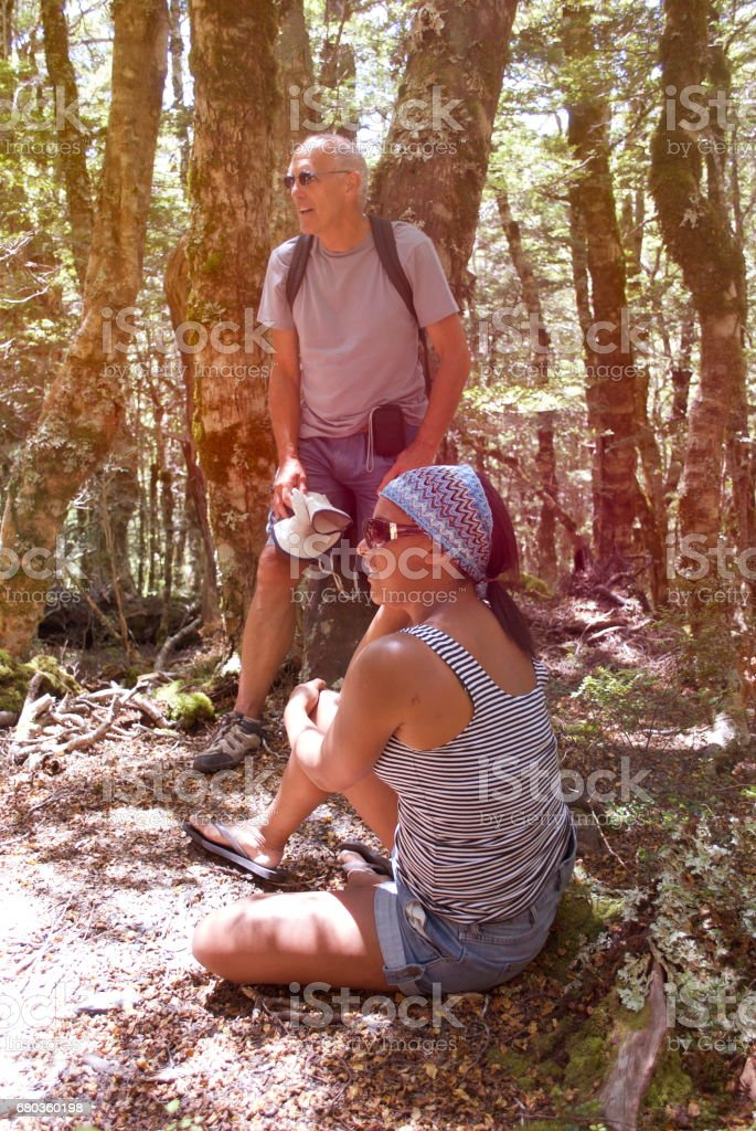 Young Woman and Senior Man in Forest, Summer stock photo
