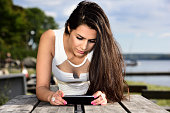 Young woman and smart phone, watching movie or thinking