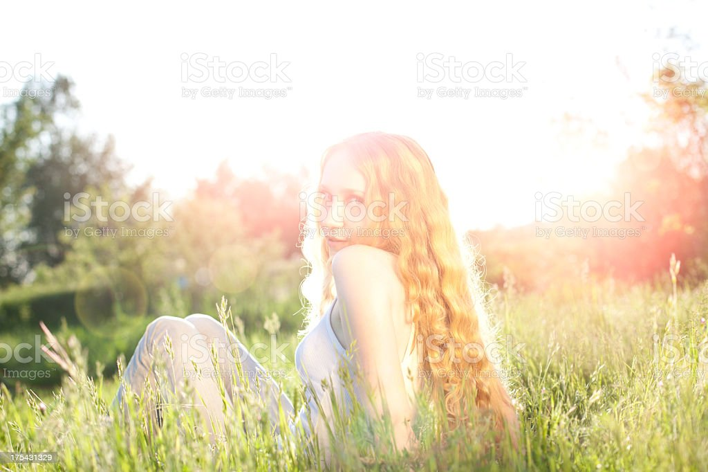 Young woman and sunbeams stock photo