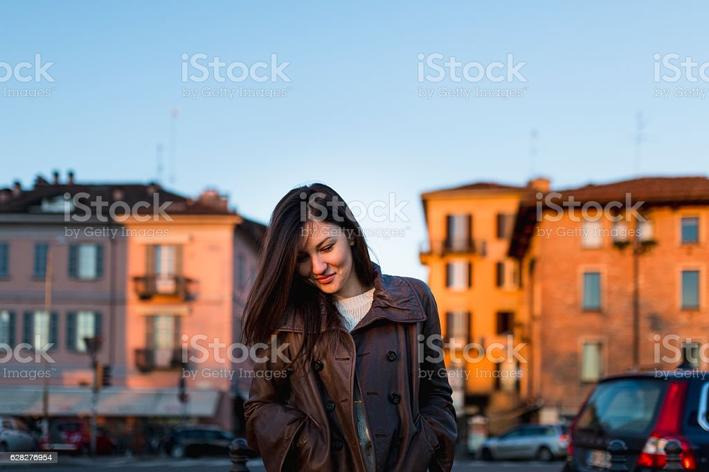 Young woman and sunset in Pavia, Italy stock photo