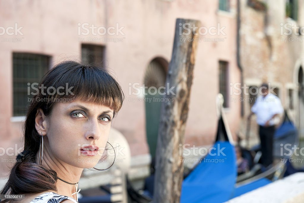 Young Woman and Venetian Gondolier royalty-free stock photo