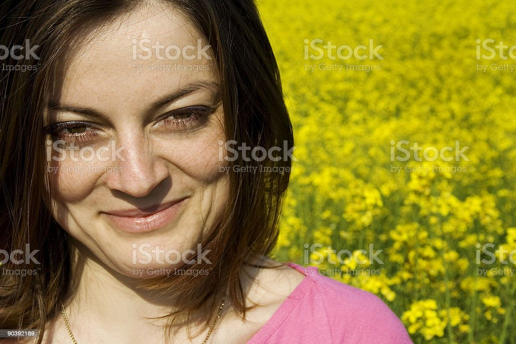 young woman and yellow flower field royalty-free stock photo