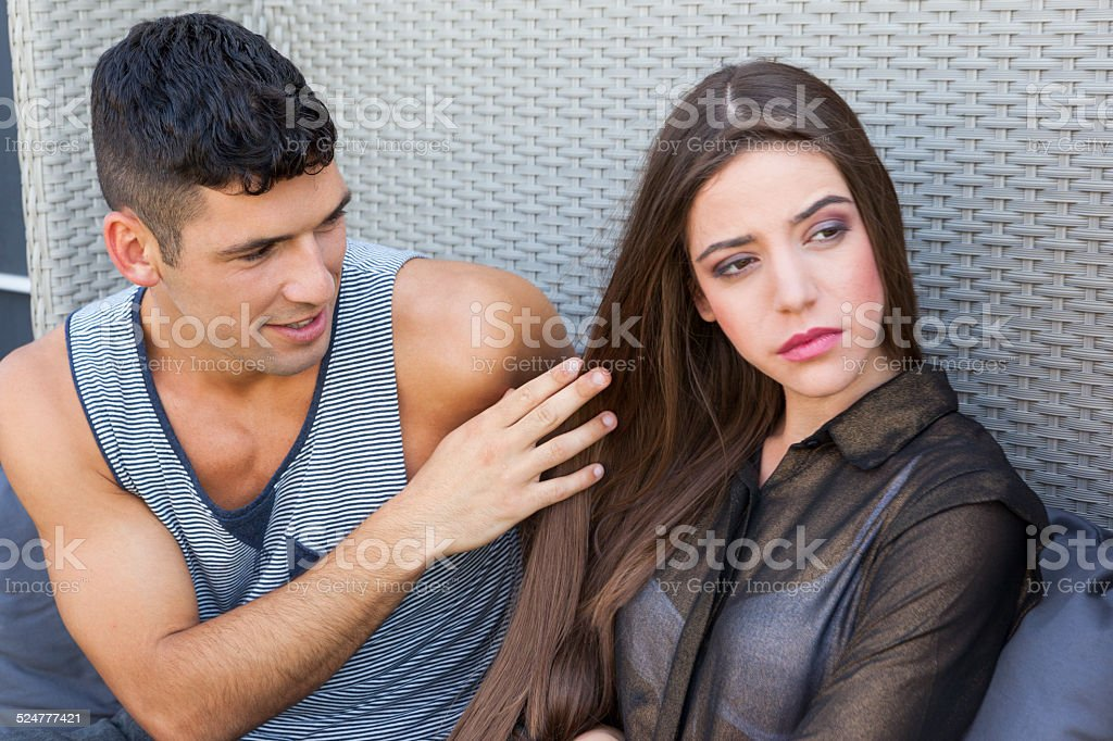Young woman angry at boyfriend stock photo
