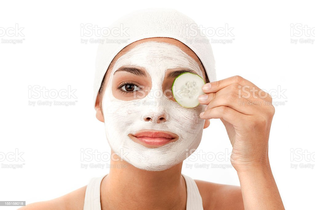 Young Woman Applying a Facial Mask - Isolated royalty-free stock photo
