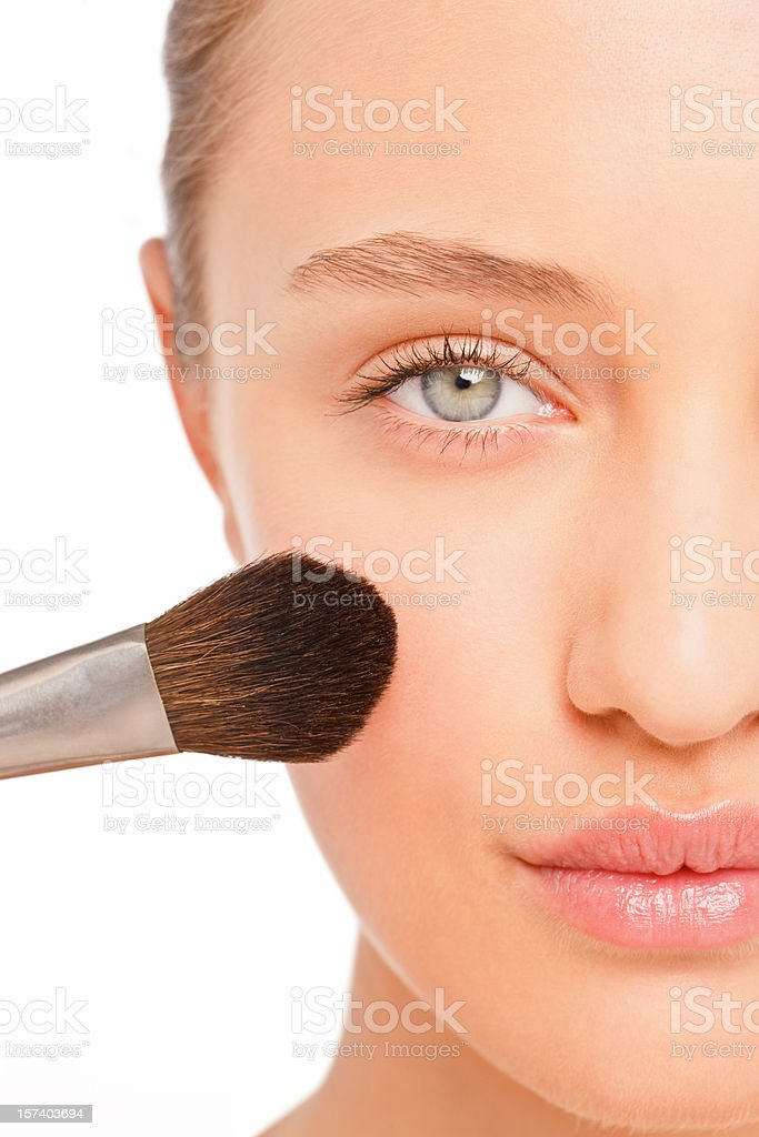 Young woman applying blusher royalty-free stock photo