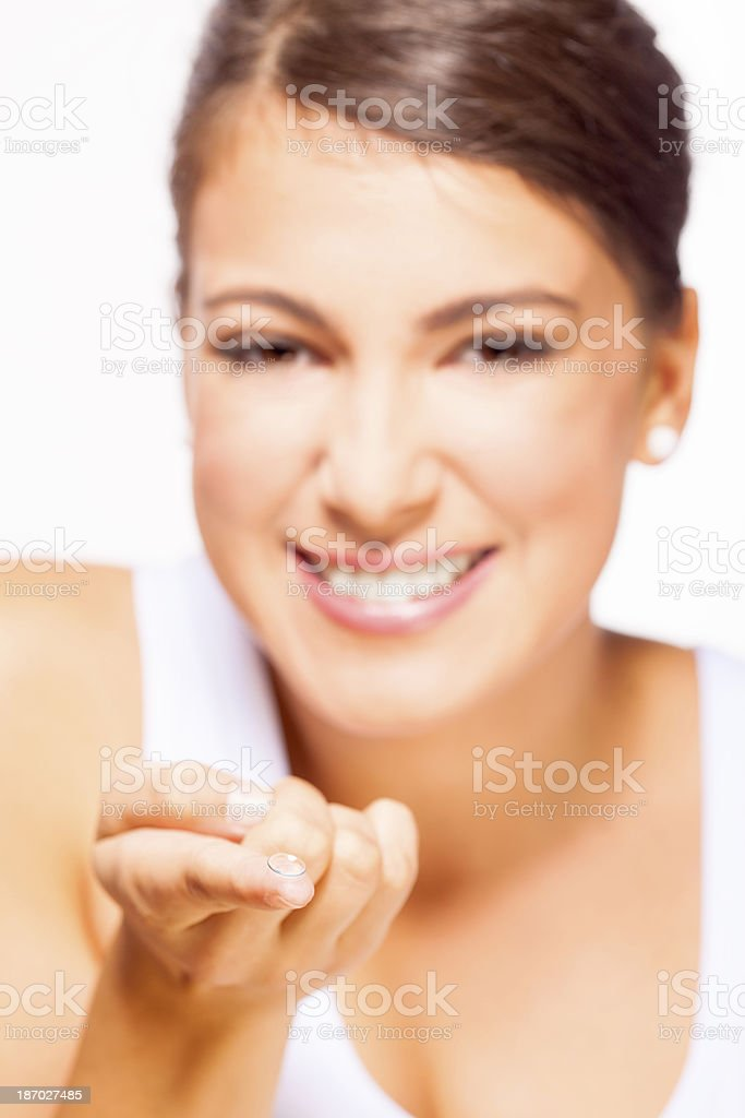 Young woman applying contact lenses royalty-free stock photo