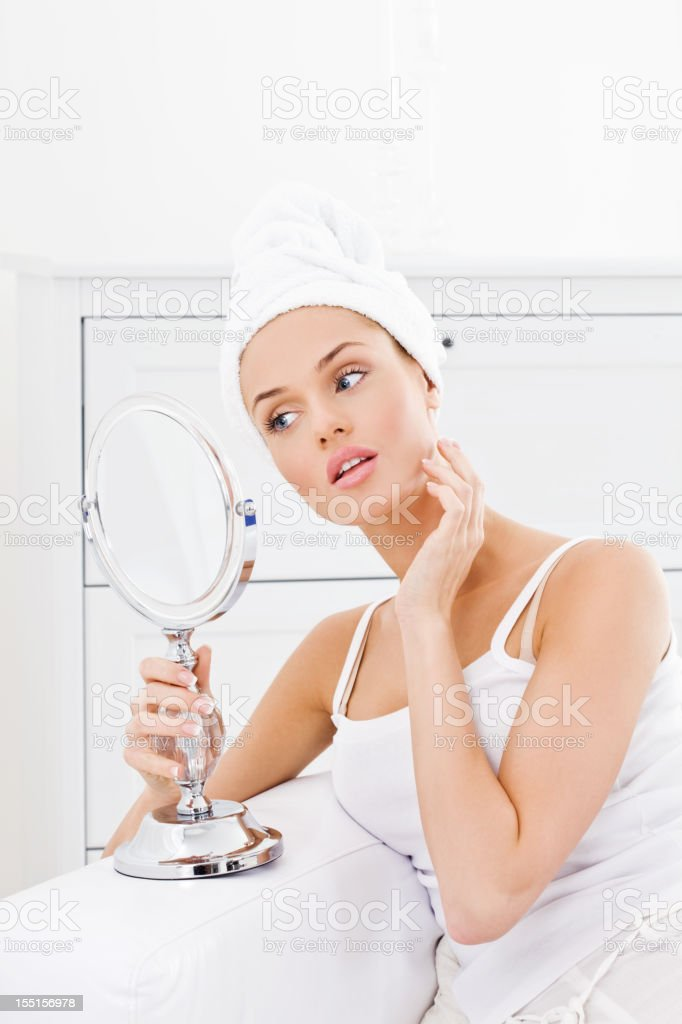 Young woman applying cream royalty-free stock photo