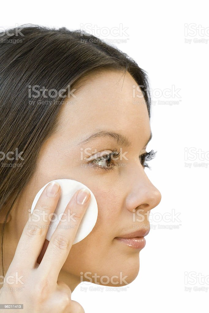 Young woman applying face cotton pads royalty-free stock photo