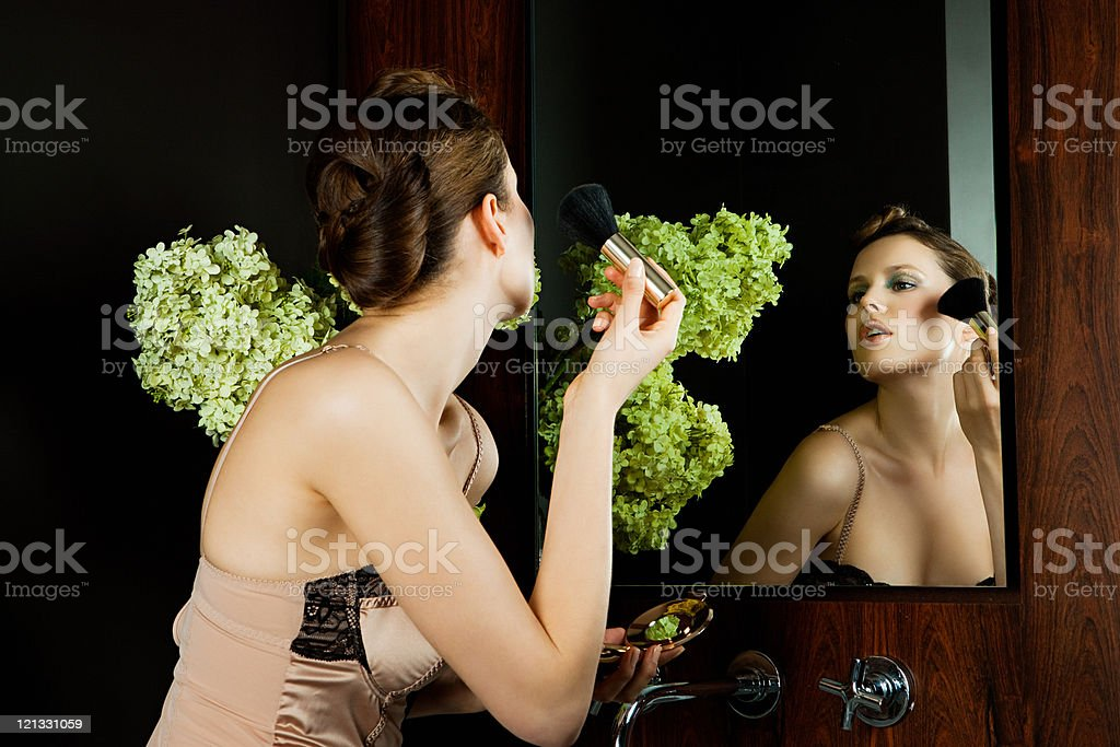 Young woman applying face powder royalty-free stock photo