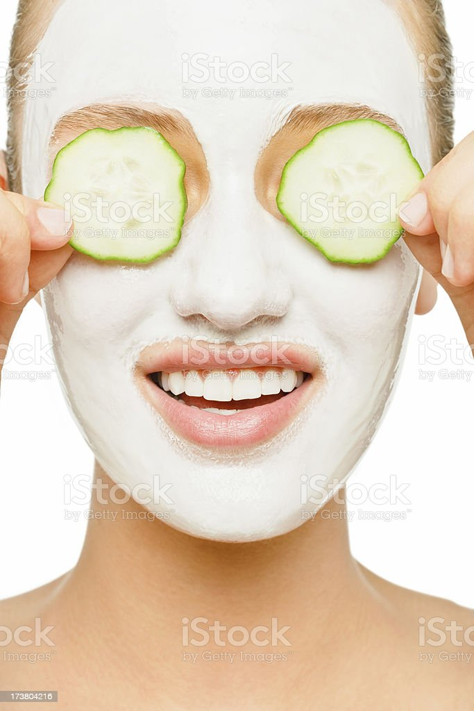 Young woman applying facial mask royalty-free stock photo
