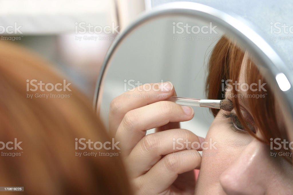 Young woman applying makeup royalty-free stock photo
