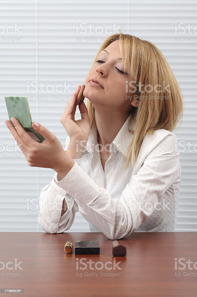 Young Woman Applying Makeup royalty-free stock photo