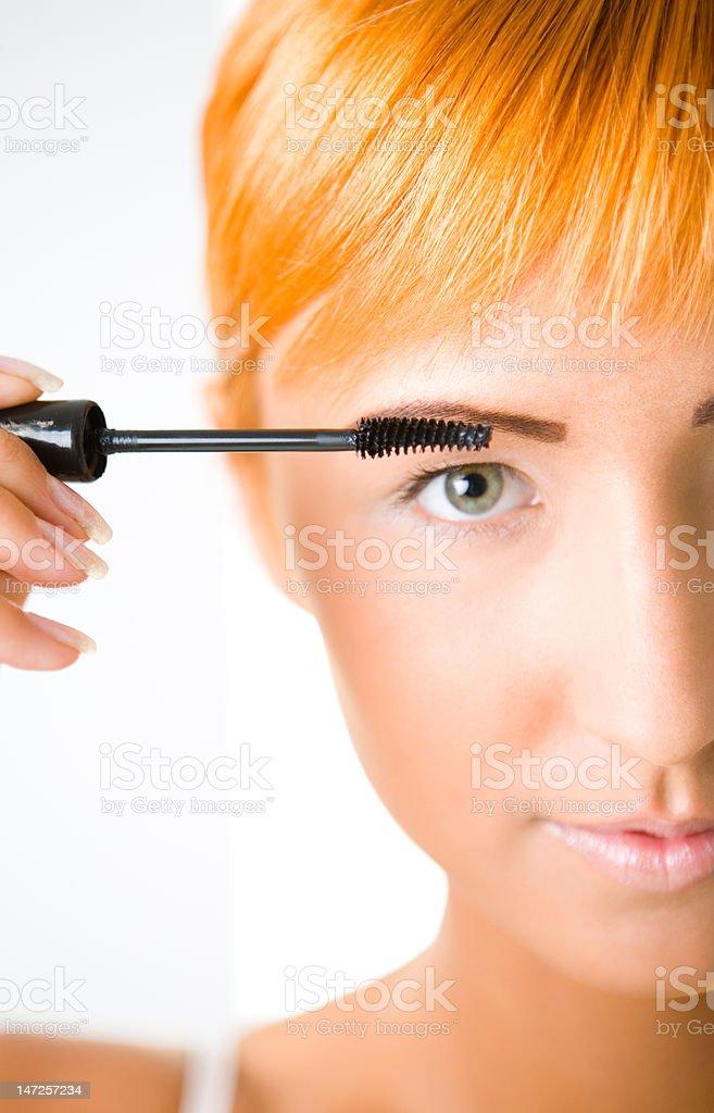 Young woman applying mascara royalty-free stock photo
