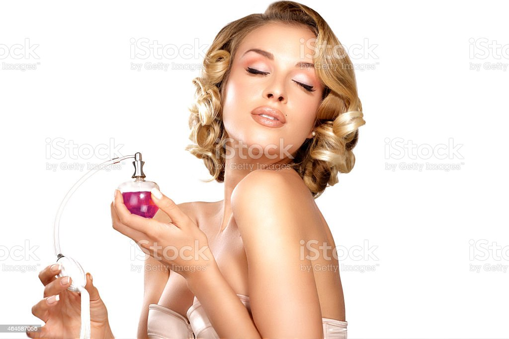 Young woman applying perfume on her neck space for text on white