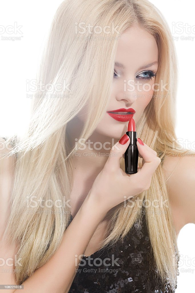 Young Woman Applying Red Lipstick royalty-free stock photo