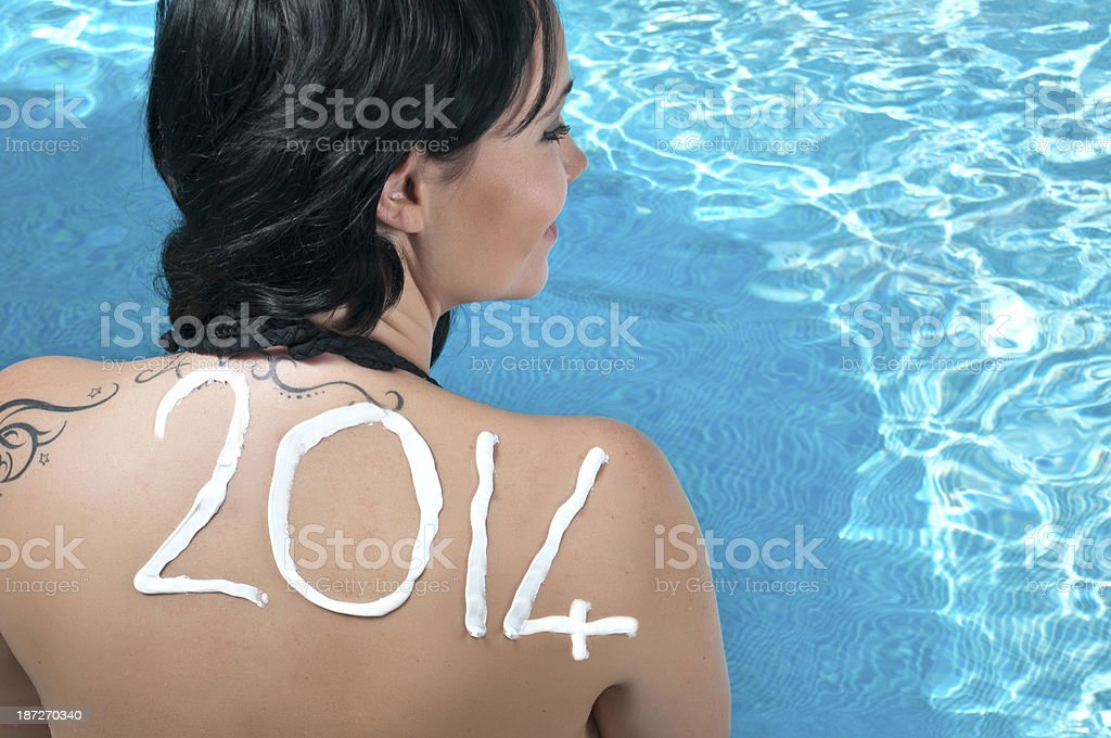 Young woman applying sun cream, concepts 2014 royalty-free stock photo