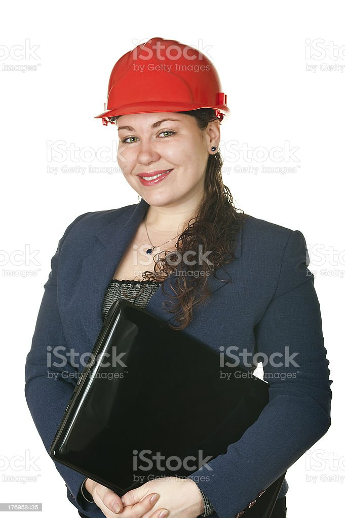 Young woman architect in red helmet and with laptop. royalty-free stock photo