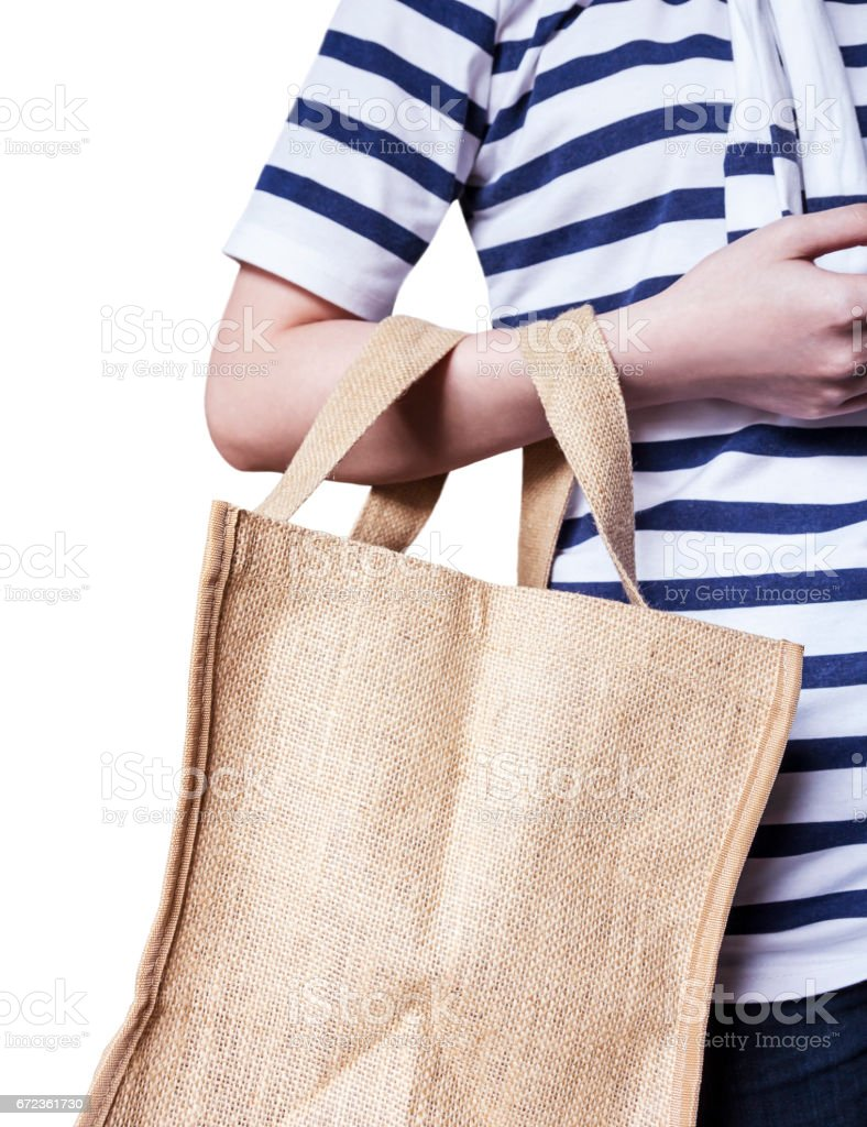 Young woman are carrying sackcloth shopping bag on white background stock photo