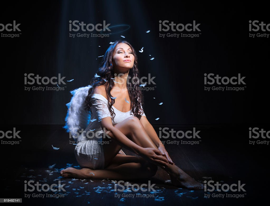 Young woman as an angel stock photo